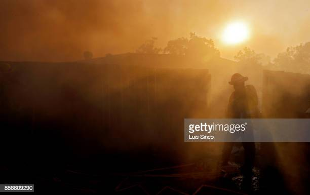 A firefighter is enveloped in thick smoke while battling the Creek Fire near the intersection of Johanna Avenue and McBroom Street in Shadow Hills on...