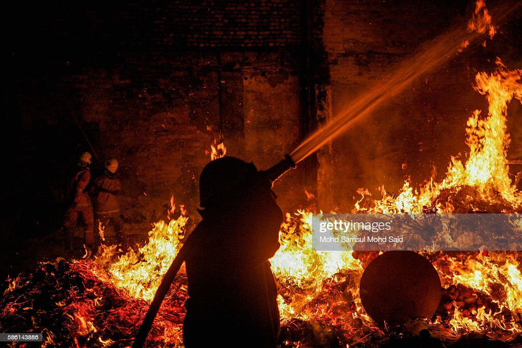 A firefighter is seen work near an effigy burn at the Hungry Ghost festival on August 6, 2016 in Kuala Lumpur, Malaysia. The Hungry Ghost Festival falls on the 15th day of the seventh lunar month. According to traditional Chinese belief, the seventh month in the lunar calendar is when restless spirits roam the earth. Many Chinese people make efforts to appease these transient ghosts, while feeding their own ancestors particularly on the 15th day, which is the Yu Lan or Hungry Ghost Festival.