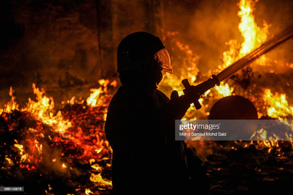 A firefighter is seen work near an effigy burn during Hungry Ghost Festival on August 6, 2016 in Kuala Lumpur, Malaysia. The Hungry Ghost Festival falls on the 15th day of the seventh lunar month. According to traditional Chinese belief, the seventh month in the lunar calendar is when restless spirits roam the earth. Many Chinese people make efforts to appease these transient ghosts, while feeding their own ancestors particularly on the 15th day, which is the Yu Lan or Hungry Ghost Festival.
