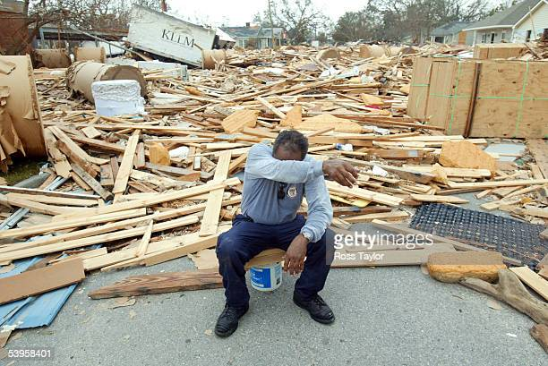 Firefighter Jerome Crenshaw wipes sweat away during a break from the recovery efforts in the aftermath of Hurricane Katrina September 1, 2005 in...