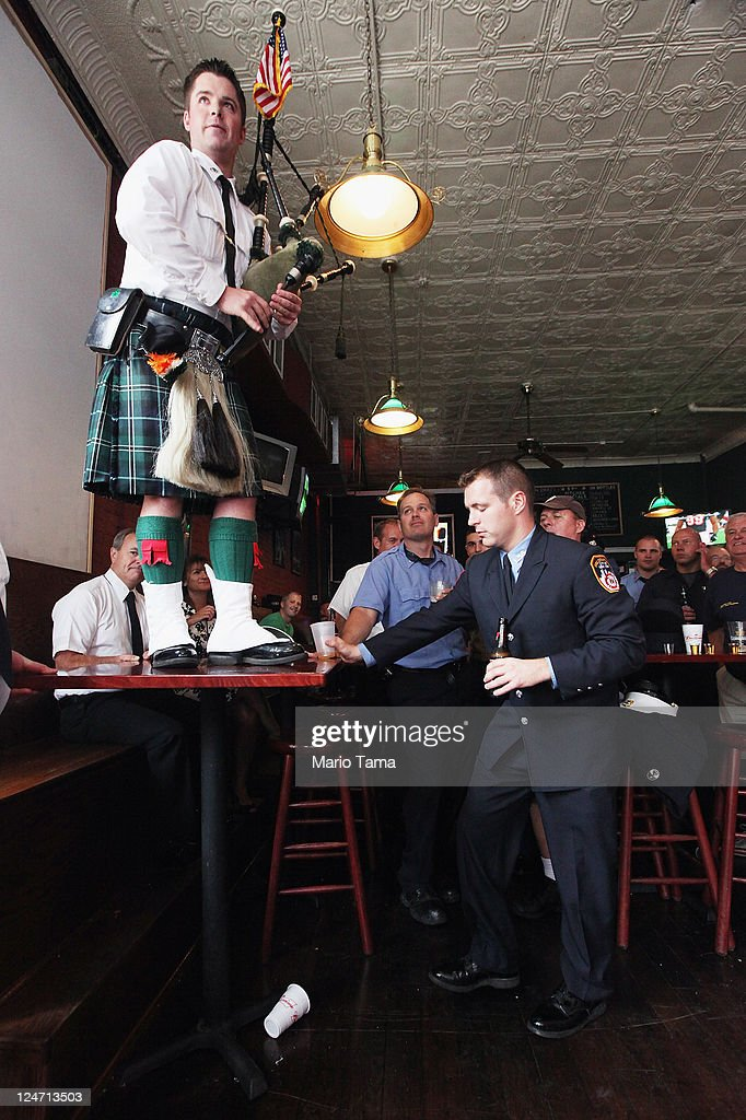 FDNY firefighter Kevin O'Connor plays bagpipes as firefighters look on at O'Connells Pub after a memorial service for firefighters killed on the 10th anniversary of the terrorist attacks on lower Manhattan at the Firemen's Monument at Riverside Park on Septemnber 11, 2011 in New York City. Firefighters from around the world have converged on New York to take part in the anniversary services. New York City and the nation are commemorating the tenth anniversary of the terrorist attacks which resulted in the deaths of nearly 3,000 people after two hijacked planes crashed into the World Trade Center, one into the Pentagon in Arlington, Virginia and one crash landed in Shanksville, Pennsylvania.
