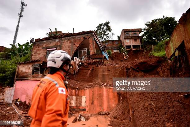 Firefighter looks at the site of a landslide in Vila Bernadete, Belo Horizonte, Minas Gerais state, Brazil, on January 26, 2020. - A landslide buried...