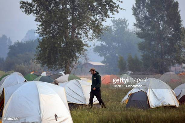 A firefighter makes his way through tents at fire camp before heading back out on the fire line of the 416 Fire on June 14 2018 in Hermosa Colorado...