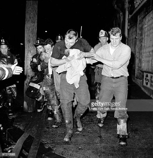 Firefighter Michael Maye tries in vain to revive twomonthold Cynthia Alvarado after an apartment fire at 940 East 165th Street Her twoyearold brother...