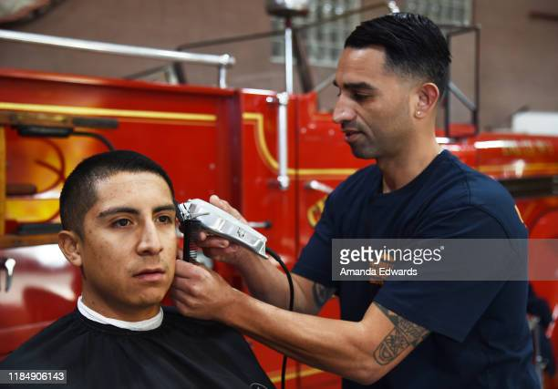 Firefighter Nestor Lorente and barber Javier Oregel attend the MOVEMBER Kickoff Event with Tarek El Moussa and Jason O'Mara at the Culver City Fire...