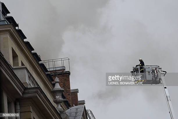 A firefighter on a platform prepares to reach the site of a fire at the landmark Ritz Hotel in Paris on January 19 2016 A major fire broke out at the...