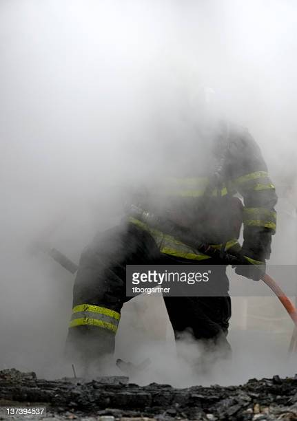 Firefighter only half visible due to smoke