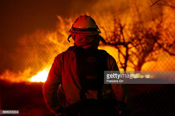 Firefighter/ parametric Robert Castillo keeps his eye on the Lilac fire in Bonsall CA December 8 2017 Currently the wind is calm and the temperature...