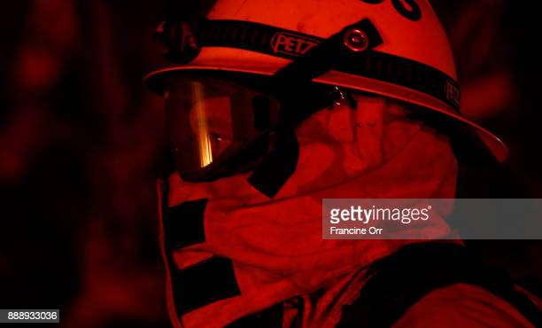 Firefighter/ parametric Robert Castillo keeps his eye on the Lilac fire in Bonsall in San Diego County Ca December 8 2017 Currently the wind is calm...