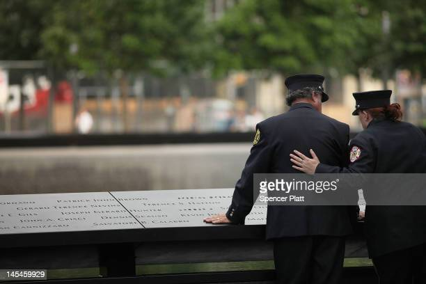 A firefighter pauses during a tribute at the 9/11 Memorial for recovery workers and first responders on the10year anniversary of the formal end of...