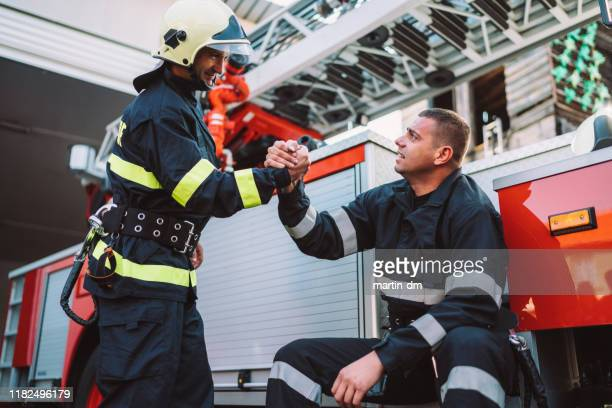 firefighter - firefighter stock pictures, royalty-free photos & images