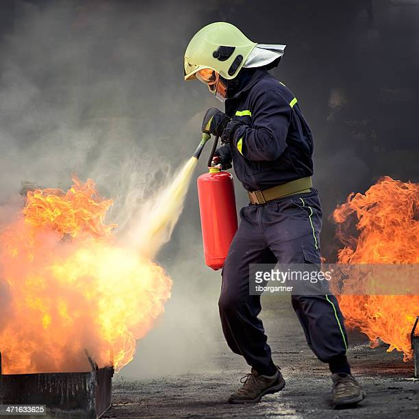 firefighter - fire extinguisher stock photos and pictures