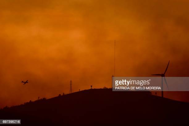 Firefighter plane tries to extinguish a wildfire in Castanheira de Pera on June 18, 2017. Portugal declared three days of national mourning from June...
