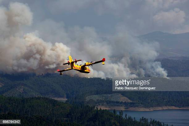 A firefighter plane works on a fire after a wildfire took dozens of lives on June 20 2017 near Pedrogao Grande in Leiria district Portugal On...