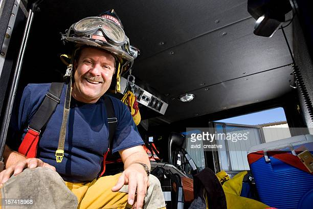 Firefighter Portrait In Fire Engine