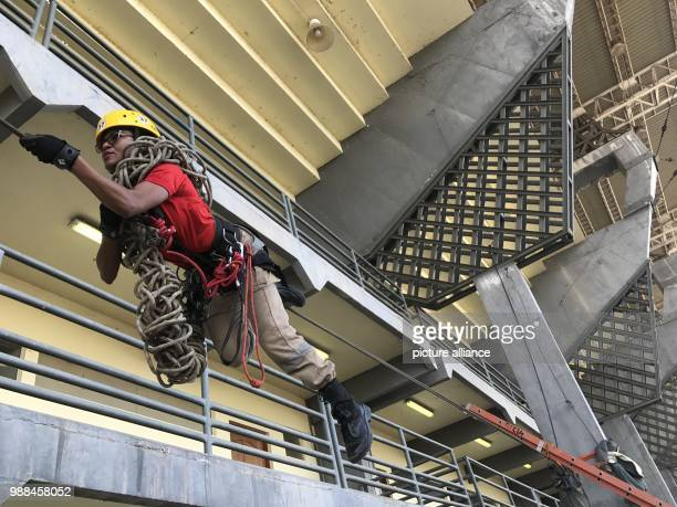 A firefighter practices a manoeuvre at the Zerao soccer stadium in Macapa Brazil 17 November 2017 Measurements show that the equator draws through...
