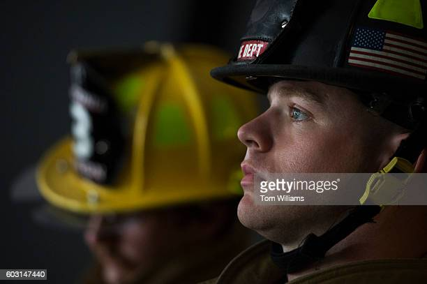 A firefighter prepares for the 9/11 Memorial Stair Climb in the Brady Sullivan Building in Manchester NH September 11 2016 Participants climb the...