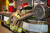 Firefighter protection gear on the fire truck bumper