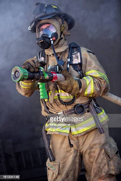 Firefighter ready to spray water