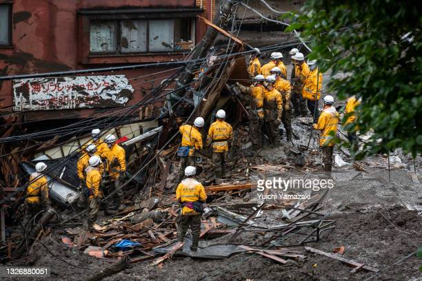 Firefighter rescue team search for missing people at the site of a landslide on July 04, 2021 in Atami, Shizuoka, Japan. Torrential rain triggered a...