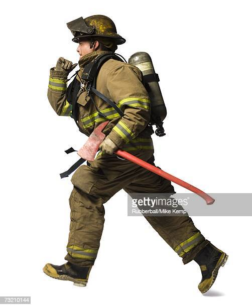 Firefighter running with axe