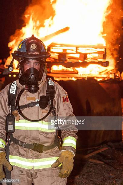 firefighter school instructor - in flames i the mask stock pictures, royalty-free photos & images