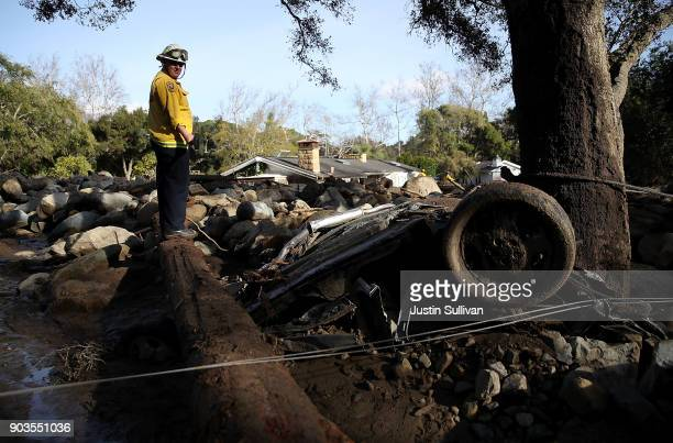 A firefighter searches for people trapped in mudslide debris on January 10 2018 in Montecito California 15 people have died and hundreds are still...