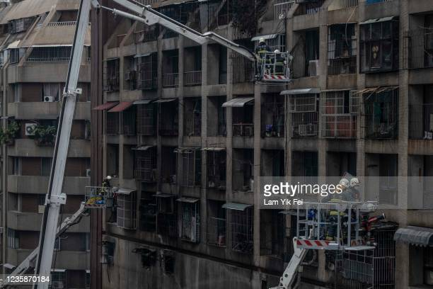 Firefighter searches for victims from a residential building in the wake of a fire on October 14, 2021 in Kaohsiung, Taiwan. Additional deaths are...