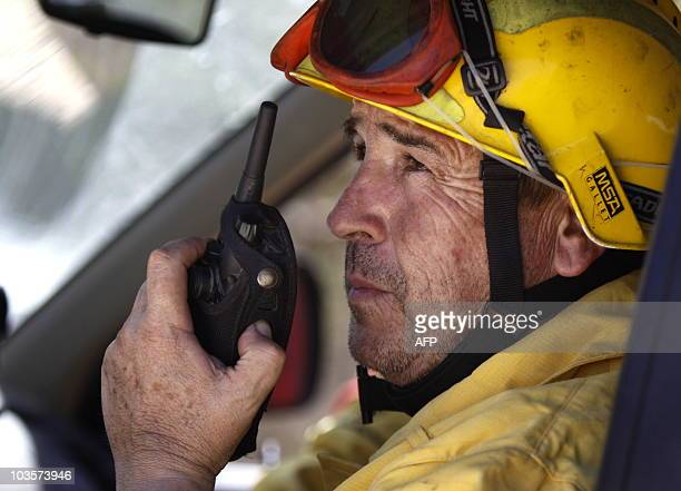A firefighter speaks on his walkietalkie at the site of a fire in Sant Joan de Labritja on Ibiza island on August 24 2010 Every Despite wind and heat...