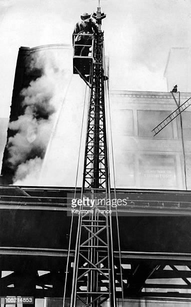 Firefighter Sprays A Burning Building In Chicago November 24 1937