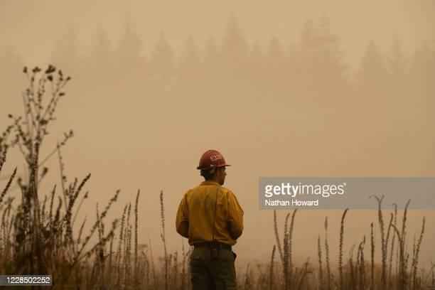 Firefighter surveys a field near the Riverside Fire on September 13, 2020 in Glen Avon, Oregon. Multiple wildfires grew by hundreds of thousands of...