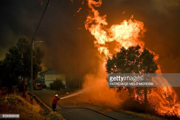 TOPSHOT A firefighter tackles a wildfire close to the village of Pucarica in Abrantes on August 10 2017 Nearly 3000 firefighters battled 80 wildfires...