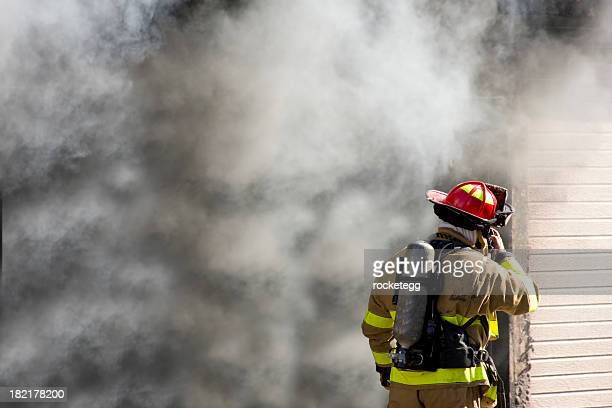 firefighter talking on radio - coat stock pictures, royalty-free photos & images