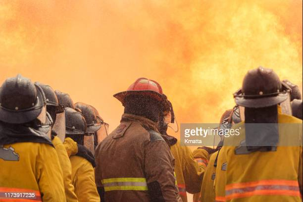 firefighter team - loyalty stock pictures, royalty-free photos & images