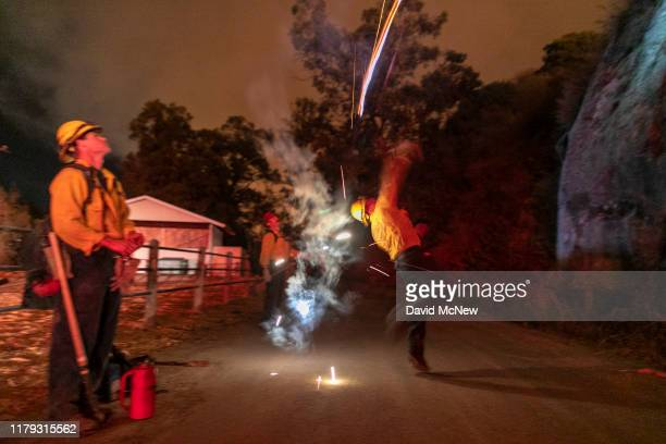 A firefighter throws a flare to start a backfire at the Maria Fire which exploded to 8000 acres on its first night on November 1 2019 near Somis...