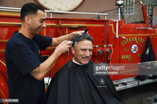 Firefighter Tim Sullivan and barber Javier Oregel attend the MOVEMBER Kickoff Event with Tarek El Moussa and Jason O'Mara at the Culver City Fire...