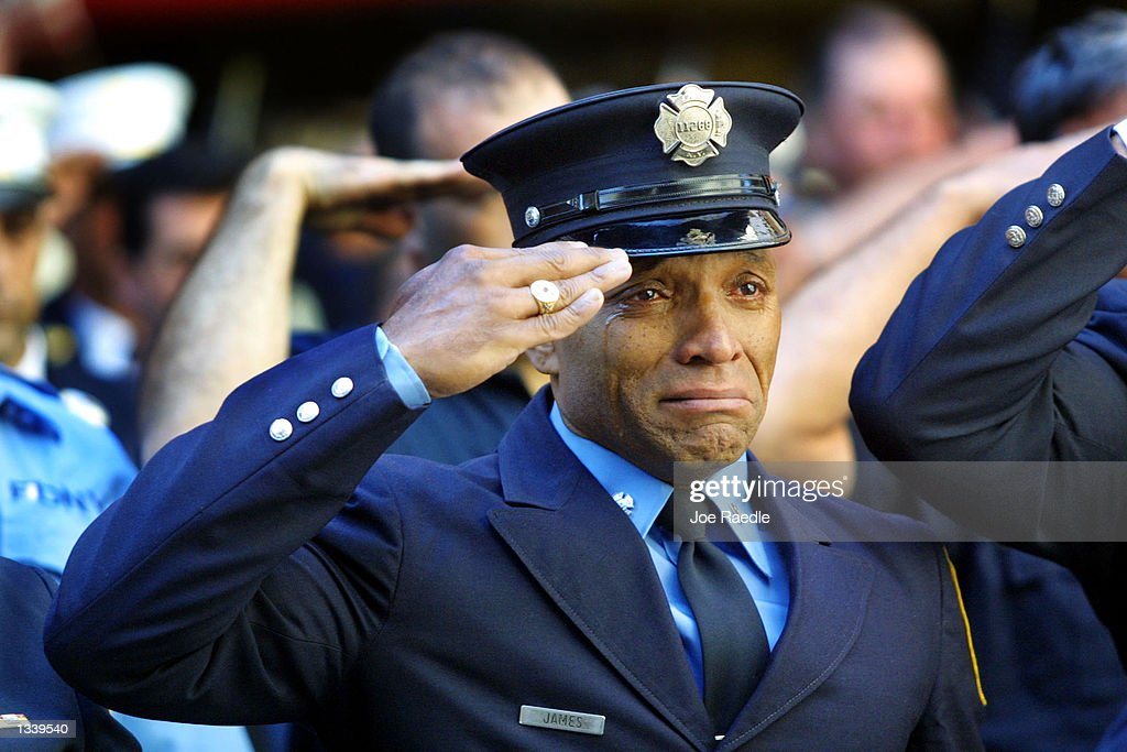 Firefighter Tony James cries while attending the funeral service for New York Fire Department Chaplain Rev. Mychal Judge, in front of the St. Francis of Assisi Church September 15, 2001 in New York City. Judge died while giving the last rites to a fireman in the collapse of the World Trade Center. The World Trade Center was destroyed after both the landmark towers were struck by two hijacked planes in a terrorist attack on September 11.