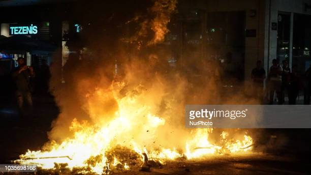 A firefighter tries to extinguish the fire by a burning garbage during 5th Anniversary of the murder of Pavlos Fyssas September 2018 marks 5 years...