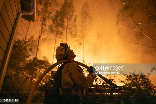 Firefighter tries to put out the wildfire on August 19, 2020 in San Mateo, California.