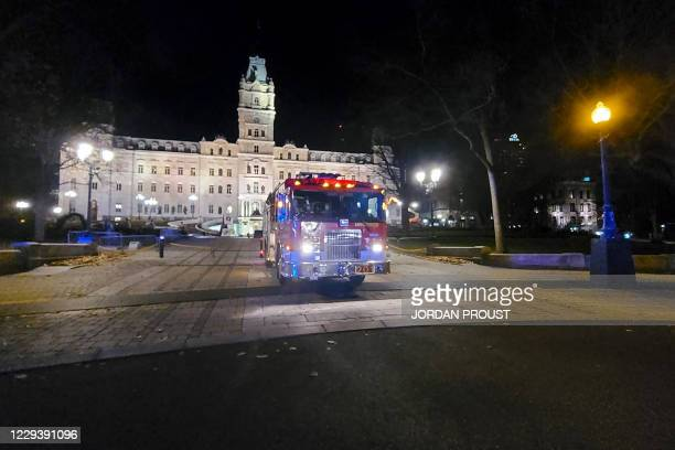 Firefighter truck is parked in front of the National Assembly of Quebec, in Quebec City, early on November 1 after two people were killed and five...
