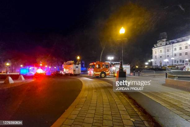 Firefighter trucks are parked in front of the National Assembly of Quebec, in Quebec City, early on November 1 after two people were killed and five...