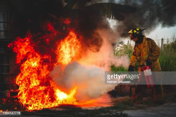 firefighter used carbon dioxide fire extinguishers. - 消火器 ストックフォトと画像