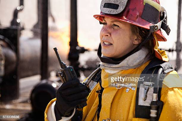 firefighter using walkie-talkie - fire protection suit stock photos and pictures