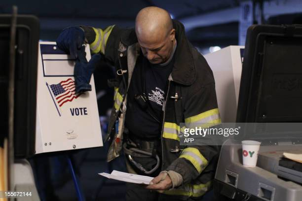 Firefighter votes in a tent that is being used as a polling place in Rockaway, Queens as New York recovers from Hurricane Sandy on November 6, 2012....