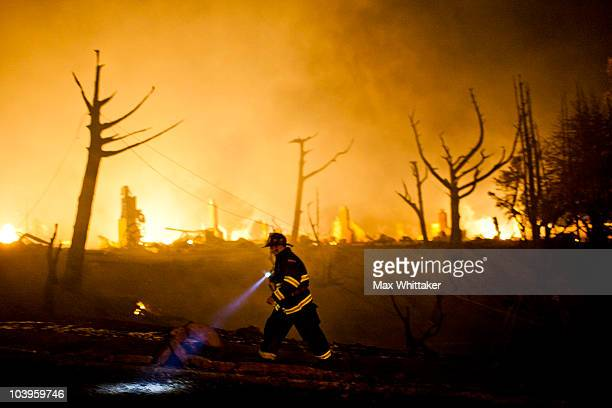 A firefighter walks around the massive fire in a residential neighborhood September 9 2010 in a San Bruno California A massive explosion rocked a...