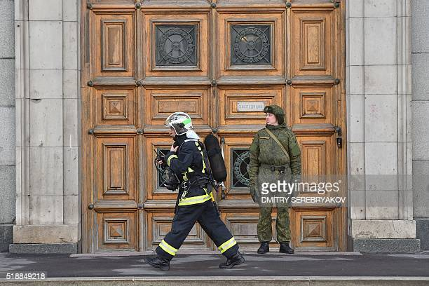 A firefighter walks at the site of a fire at a building of Russia's Defence Ministry in central Moscow on April 3 2016 / AFP / Dmitry Serebryakov