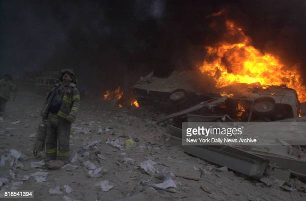 Firefighter walks in rubble of World Trade Center after it was destroyed by planes in a terrorist attack.