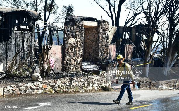 A firefighter walks past destroyed homes along North Tigertail Road near The Getty Center in Los Angeles California on October 29 2019 More than 1000...