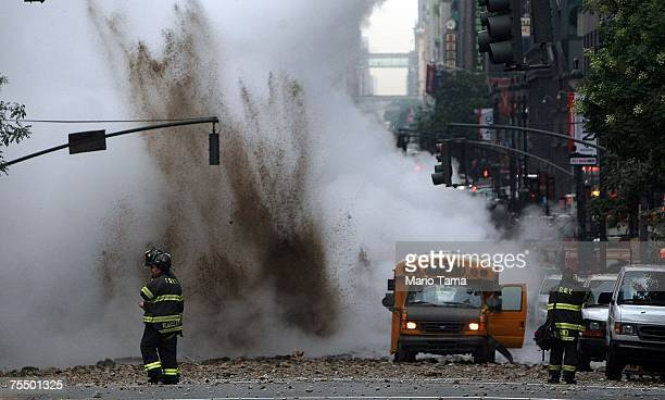 A firefighter walks past the scene of a steam pipe explosion on Lexington Avenue July 18 2007 in New York City Steam and mud were forced from the...