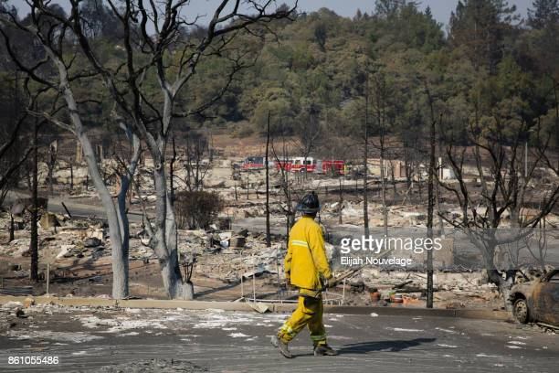 Firefighter walks through the remains of the Fountaingrove neighborhood on October 13, 2017 in Santa Rosa, California. Twenty four people have died...